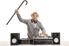 Excited mature man playing music on a turntable Stock Photo