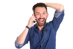 Excited mature man using on cellphone and laughing. Portrait of excited mature man using on cellphone and laughing over white background royalty free stock image