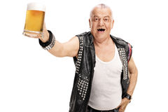 Excited mature punker holding a pint of beer. And looking at the camera isolated on white background royalty free stock photo
