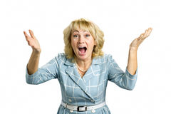 Excited mature woman, white background. Stock Photography