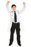Excited medical doctor rejoicing his success. Isolated on white Royalty Free Stock Photo