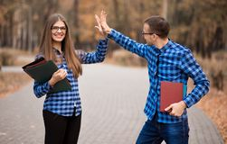 Excited man and woman screaming with joy raising hands, happy young couple celebrate online win victory, goal achievement royalty free stock photography