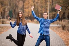 Excited man and woman screaming with joy raising hands, happy young couple celebrate online win victory, goal achievement stock photography