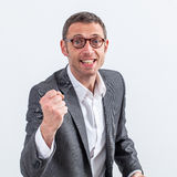 Excited middle aged businessman with fist for success Stock Image