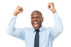 Excited middle aged male executive. Excited african entrepreneur clenching his fists Stock Photo
