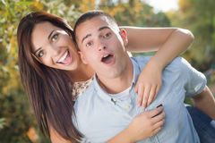 Excited Mixed Race Couple Give Piggyback Ride Stock Image