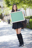 Excited Mixed Race Female Student Holding Blank Chalkboard Royalty Free Stock Photography