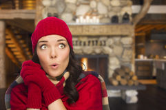 Excited Mixed Race Girl Enjoying Warm Fireplace In Rustic Cabin Stock Photography