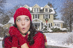 Excited Mixed Race Woman in Winter Clothing Outside in Snow Royalty Free Stock Photo