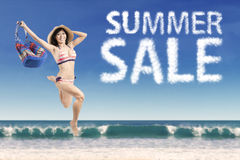 Excited model with summer sale cloud Stock Photo