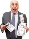 Excited About The Money!. A slimy, balding businessman looks excited as he holds wads of cash, isolated on a white background Royalty Free Stock Photography