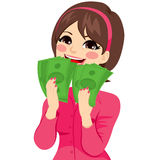 Excited Money Businesswoman. Young brunette businesswoman really excited enjoying and holding big fan of green money with both hands Royalty Free Stock Photos