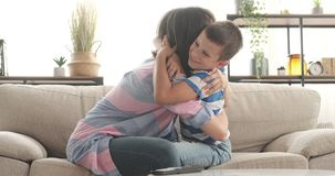 Loving mother embracing son at home. Excited mother embracing her loving son at home stock video