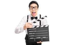 Excited movie director holding a clapperboard Royalty Free Stock Photography