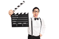 Excited movie director holding a clapperboard Stock Image