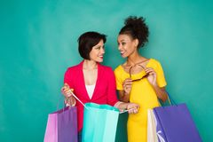 Excited multiethnic girls with shopping bags Stock Photo