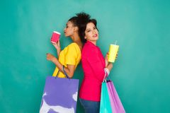 Excited multiethnic girls with shopping bags Royalty Free Stock Photos