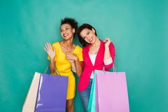 Excited multiethnic girls with shopping bags Stock Photography