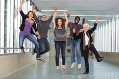 Excited Multiethnic University Students Jumping Royalty Free Stock Photography