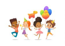 Excited multiracial boys and girls with the balloons and birthday hats happily jumping with their hands up. Birthday