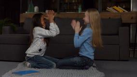 Joyful multi ethnic children playing clapping game stock footage