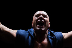 Excited muscular man shouting Royalty Free Stock Photography