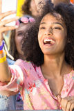 Excited music fans at festival Stock Images