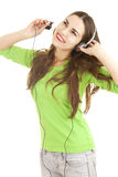 Excited music young woman in headphones Stock Image