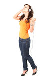 Excited music young woman in headphones Stock Photo