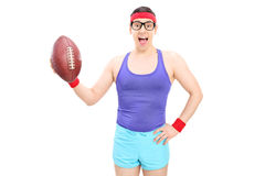 Excited nerdy guy holding a football Stock Images