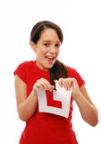 Excited new driver. Proud girl tearing her L plate after passing driving test Stock Photos