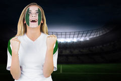 Excited nigeria fan in face paint cheering Royalty Free Stock Images