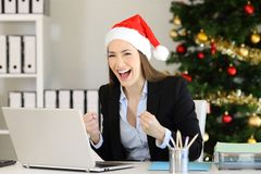 Excited office worker looking at camera in christmas royalty free stock image