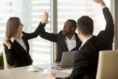 Excited business partners celebrating success. Excited office workers giving high five celebrating wages or sales increase, successful deal, promotion at work Royalty Free Stock Photos
