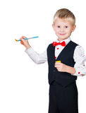 Excited painting boy isolated on white background. Excited painting boy wearing classic suit isolated on white background Stock Photos
