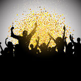 Excited party crowd on confetti background Royalty Free Stock Image