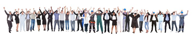 Excited people with different occupations celebrating success. Full length of excited people with different occupations celebrating success over white background Stock Images