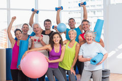 Excited people holding exercise equipment Royalty Free Stock Photo