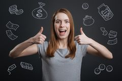 Excited person putting thumbs up after winning a lot of money. Rich person. Excited young woman putting her thumbs up and smiling happily after winning a big sum royalty free illustration