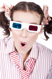 Amazed woman watching 3D movie in glasses Stock Image