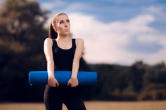 Excited Pilates Girl with Yoga Mat Standing Stock Images