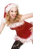 Excited pin up Mrs Santa Claus with candy cane. Blond excited pinup dancing woman in Christmas outfit and thigh high black leather boots holding candy cane stick Royalty Free Stock Photos