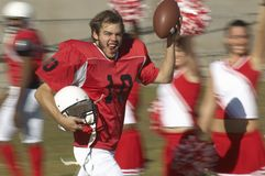 Excited Player Running With Ball Royalty Free Stock Photos