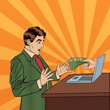 Excited Pop Art Business Man Receiving Money from Laptop Stock Image