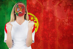 Excited portugal fan in face paint cheering Stock Photography