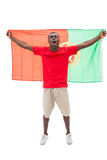 Excited portugal football fan in red cheering Royalty Free Stock Photos