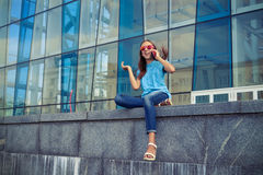 Excited and positive girl in lovely casual outfit has rather liv Royalty Free Stock Image