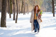 Excited positive woman going through snowdrifts in winter forest royalty free stock photo