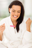 Excited pregnancy test royalty free stock photography