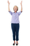 Excited pretty aged lady, full length shot. Royalty Free Stock Photography